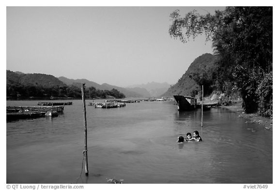 River with kids playing, Son Trach. Vietnam (black and white)