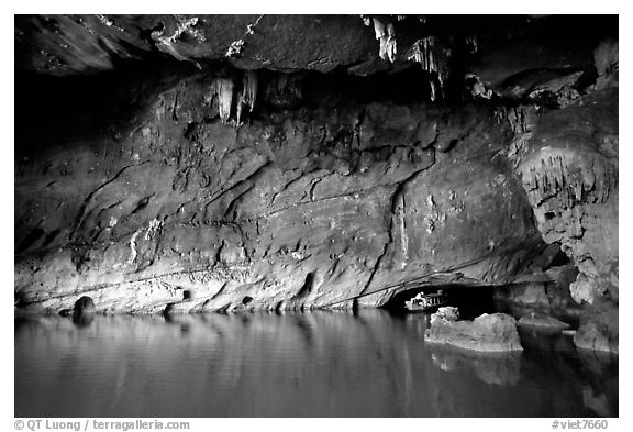 Tour boat getting out of a tunnel, Phong Nha Cave. Vietnam (black and white)