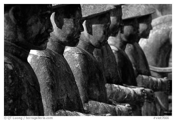 Row of statues in Khai Dinh Mausoleum. Hue, Vietnam (black and white)