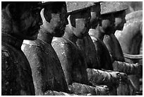 Row of statues in Khai Dinh Mausoleum. Hue, Vietnam ( black and white)