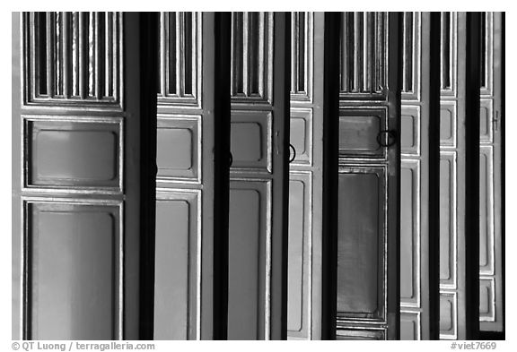 Red doors of the shrine inside the Minh Mang Mausoleum. Hue, Vietnam (black and white)