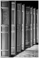 Red doors of the temple inside the Minh Mang Mausoleum. Hue, Vietnam ( black and white)