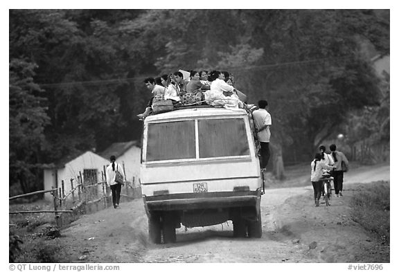 Passengers sitting on top of an overloaded bus. Northest Vietnam (black and white)