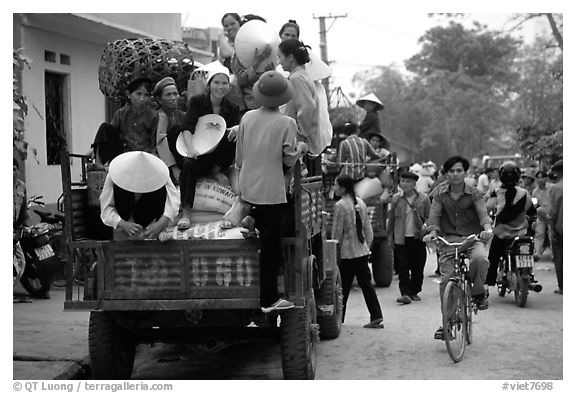 Riding in the back of an overloaded truck. Northest Vietnam (black and white)