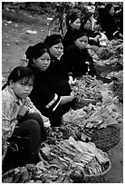Women of the Nung hill tribe sell vegetables at the Cao Bang market. Northeast Vietnam (black and white)