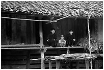 Women and child of the Nung ethnicity in front of their home. Northeast Vietnam (black and white)