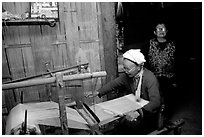 Elderly woman weaving in her home. Northeast Vietnam ( black and white)