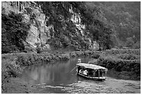 Shallow boats transport villagers to a market. Northeast Vietnam ( black and white)