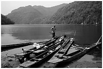 Dugout boats on the shore of Ba Be Lake. Northeast Vietnam (black and white)