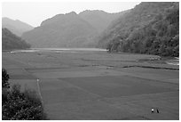 Rice fields below the Pac Ngoi village on the shores of Ba Be Lake. Northeast Vietnam (black and white)