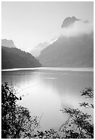Morning mist on the tall cliffs surrounding Ba Be Lake. Northeast Vietnam ( black and white)