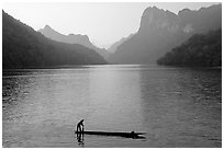 Fisherman on Dugout boat,  Ba Be Lake. Northeast Vietnam ( black and white)