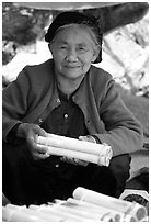 Woman selling sweet rice cooked in bamboo tubes. Vietnam ( black and white)