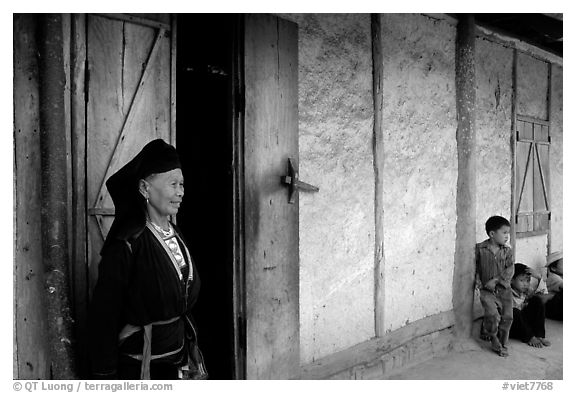 Elderly  tribewoman outside her house, near Mai Chau. Northwest Vietnam (black and white)
