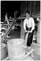 Woman of the Thai ethnicity milling grain, near Mai Chau. Northwest Vietnam ( black and white)
