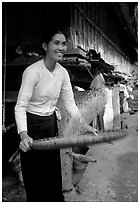Woman of the Thai ethnicity sorting grain, near Mai Chau. Vietnam ( black and white)