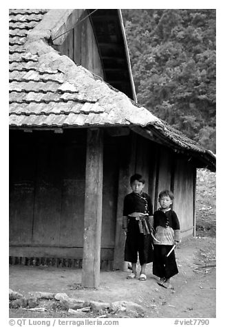 Two Hmong boys outside their house in Xa Linh village. Northwest Vietnam (black and white)