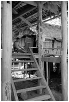 Elderly Montagnard man wearing the French beret on his porch, near Son La. Northwest Vietnam (black and white)