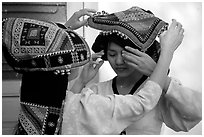 A thai woman helps her friend with her elaborate headdress, Son La. Northwest Vietnam ( black and white)