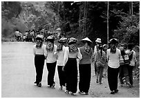 Young thai women walking on the road, between Son La and Tuan Chau. Northwest Vietnam ( black and white)
