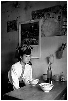 Thai woman in a restaurant, Tuan Chau. Northwest Vietnam ( black and white)