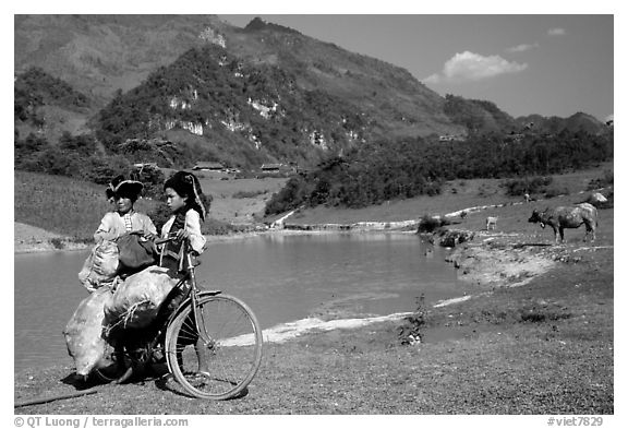 Thai women load a bicycle, near Tuan Giao. Northwest Vietnam (black and white)