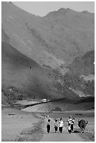 Villagers walking on the road, near Tuan Giao. Northwest Vietnam ( black and white)