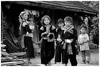 Hmong family in front of their home, near Tam Duong. Northwest Vietnam (black and white)