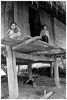 Two children in a stilt house, between Lai Chau and Tam Duong. Northwest Vietnam ( black and white)