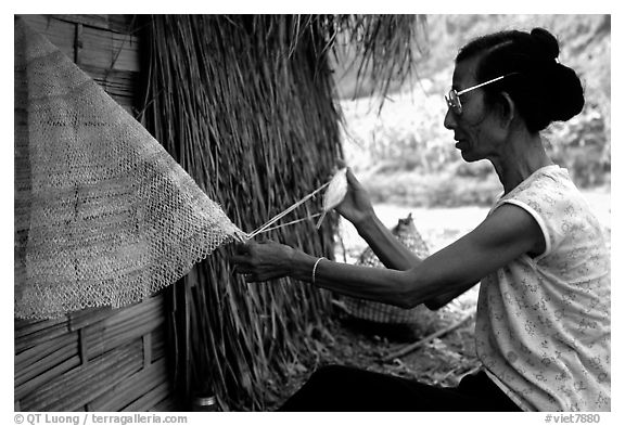 Woman sewing a net, between Lai Chau and Tam Duong. Northwest Vietnam (black and white)