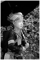 Hmong girl sheltering herself and her younger sibling with an unbrella, between Lai Chau and Tam Duong. Northwest Vietnam ( black and white)