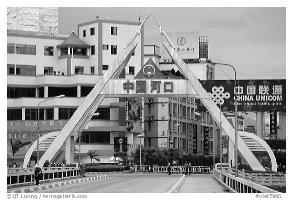 The Chinese side of the border crossing at Lao Cai. Vietnam (black and white)