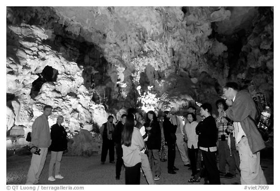Tourists in illuminated cave. Halong Bay, Vietnam (black and white)
