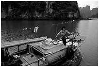 Peddling from a boat. Halong Bay, Vietnam (black and white)