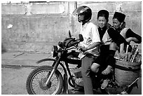 Black Hmong Women riding at the back of a Russian motorbike. Sapa, Vietnam (black and white)