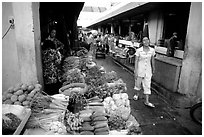 Vegetables for sale in an alley of the Ben Than Market. Ho Chi Minh City, Vietnam ( black and white)