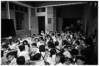 School children in an outdoor class. Ho Chi Minh City, Vietnam (black and white)