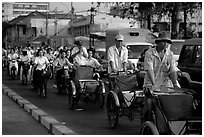 Cyclos and morning traffic. Ho Chi Minh City, Vietnam (black and white)
