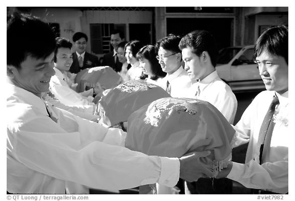 Gifts are exchanged in front of the bride's home. Ho Chi Minh City, Vietnam (black and white)