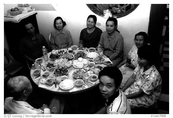 Family meal. Ho Chi Minh City, Vietnam (black and white)