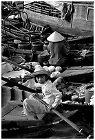Child at Phung Hiep floating market. Can Tho, Vietnam (black and white)
