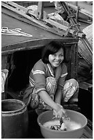 Woman doing laundry on live-aboard boat, the cheapest and most convenient housing in the Delta, near Can Tho. Vietnam ( black and white)