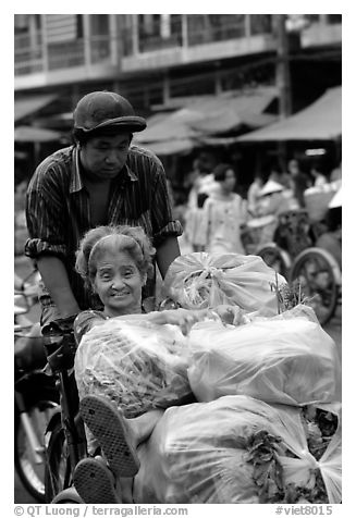 Elderly woman back from the market with plenty of groceries makes good use of cyclo. Cholon, Ho Chi Minh City, Vietnam (black and white)