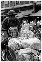 Elderly woman back from the market with plenty of groceries makes good use of cyclo. Cholon, Ho Chi Minh City, Vietnam ( black and white)
