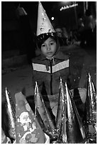 Child on Christmas night. Ho Chi Minh City, Vietnam (black and white)
