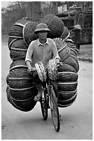 How large a load can you have on  a bicycle ?  On the way to the Perfume Pagoda. Vietnam ( black and white)
