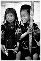 Black Hmong girls, with their daily fix of sugar cane, Sapa. Vietnam ( black and white)