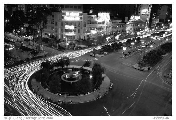 Intersection of Le Loi and Nguyen Hue boulevards at night. Ho Chi Minh City, Vietnam (black and white)