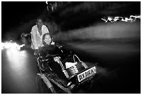 Enjoying the freshness of the night during a cyclo ride. Ho Chi Minh City, Vietnam (black and white)