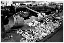 Selling freshly unloaded bananas near the Saigon arroyo. Cholon, Ho Chi Minh City, Vietnam ( black and white)